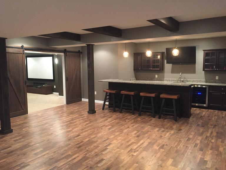 Stained barn doors. Reclaimed wooden post's and beams. Custom bar with granite tops.