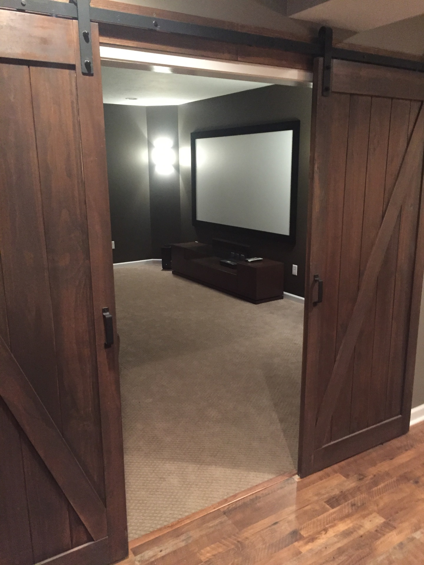 Home theater barn doors